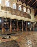 BETHLEHEM, ISRAEL - FEBRUARY 19, 2013: Pilgrims praying in Churc Royalty Free Stock Image