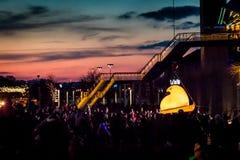Bethlehem, PA, USA: 12-30-2018 Peeps Fest at Steel Stacks. A 400-lb yellow Peep, an icon of the Just Born Company marshmallow Peeps, rises via crane to the stock photo