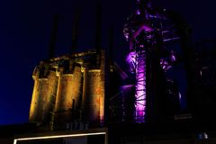 Steel stacks with purple and yellow lighting as entertainment area in downtown Bethlehem Pa. Bethlehem steel stacks turned into public entertainment area in Royalty Free Stock Photography