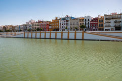 Betis street, Triana district of Seville seen from the river. View of Betis street in Triana district of Seville from the Guadaquivir river, Spain royalty free stock image