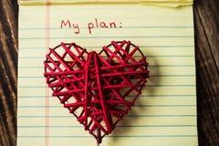 Betitla mitt plan i anteckningsbok och handgjord hjärta Arkivfoton
