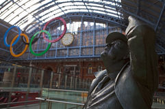 Betjeman Statue and Olympic Rings at St Pancras. The John Betjeman Statue and Olympic Rings at St Pancras International Station in London Royalty Free Stock Images