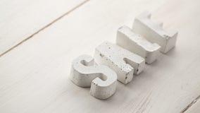 betonów listy na drewnianej desce Zdjęcia Stock