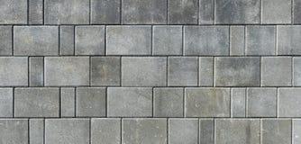 Beton of cobble grijze bestratingsplakken of stenen voor vloer, wal stock afbeelding