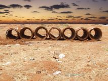 Beton tubes in front of the sea Stock Photography