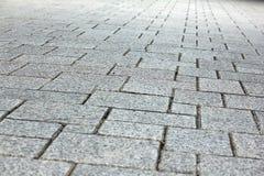 Betonblöcke niedergelegt auf dem Boden Stockfoto