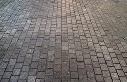 Betonblock gepflasterte Bahn für Hintergrund Lizenzfreie Stockfotos