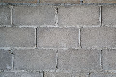 Betonblockwandhintergrund Stockbilder