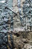Betondecke mit den Streifen des schwarzen Teers Stockbilder