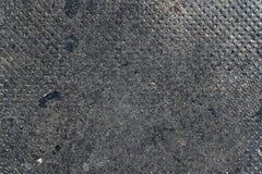 Betong som gropigt slut för golvtexturfoto upp royaltyfri foto
