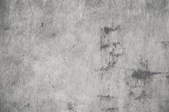 Betongvägg med smutsiga fläckar och skrapor, texturerad backgrou Royaltyfri Fotografi