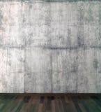 Betongvägg- och trägolv Arkivfoto