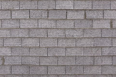 Betonmauer und graue Ziegelsteine Stockfotografie