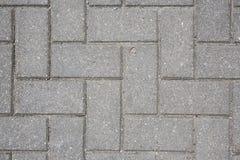 Betonowa płytka na zmielonym bruk ścieżki abstrakta wzoru tekstury tła zakończenia strzale Fotografia Stock