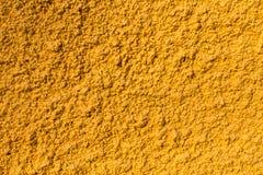 Betonowej ściany draka tekstury żółty tło Zdjęcie Stock