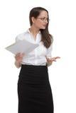 Betonte Geschäftsfrau mit dem Papiergestikulieren Lizenzfreie Stockbilder