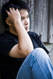 Betonter asiatischer Mann Stockbild