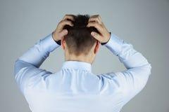 Betonter Geschäftsmann mit Kopfschmerzen Lizenzfreie Stockfotografie