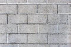 Betonuje bruków kamienie lub brukuje szare cegiełki lub obraz royalty free