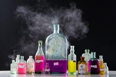 Betoveringen in antieke flessen Stock Afbeeldingen
