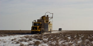 Betpakdala - steppe of southern Kazakhstan. Rig moves wheeled tractors across the steppe Stock Images
