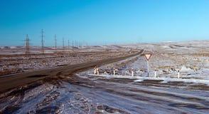 Betpakdala - steppe of southern Kazakhstan. Roads in the winter, in the steppes of southern kazahsana Stock Photo