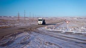 Betpakdala - steppe of southern Kazakhstan. Roads in the winter, in the steppes of southern kazahsana Royalty Free Stock Photo