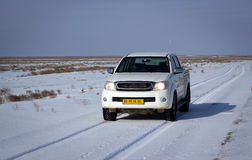 Betpakdala - steppe of southern Kazakhstan. Sports utility vehicle moved across the steppe in winter Stock Photo
