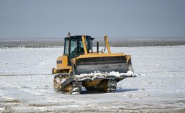 Betpakdala - steppe of southern Kazakhstan. Sports utility vehicle moved across the steppe in winter Stock Image