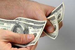betrakta pengar Arkivbilder