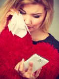 Sad heartbroken woman looking at her phone. Betrayal, bad relationship, hurt love concept. Sad heartbroken woman crying and looking at her phone Stock Image