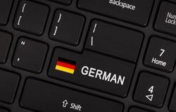 Betreten Sie Knopf mit Flagge Deutschland - Konzept der Sprache Stockfotos