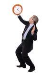Betrokken zakenman die een klok bekijkt Royalty-vrije Stock Afbeeldingen