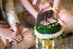 Betrothal  and wedding rings / Traditional Thai wedding. - (Selec. Betrothal and wedding rings / Traditional Thai wedding. - (Selective focus Stock Photo