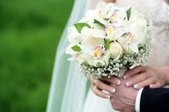 Betrothed pair holding a delicate bouquet Stock Photography