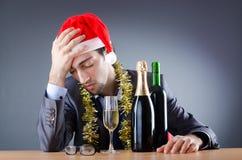Betrunkener Geschäftsmann nach Weihnachtsfest Stockbilder