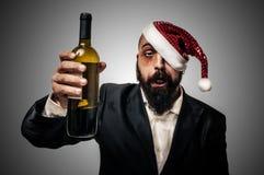 Betrunkenes modernes elegantes Weihnachtsmann babbo natale Stockfotos