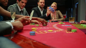 Bets being placed at poker game stock video footage