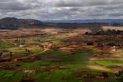 Betsileo landscape at Madagascar. A landscape of the Betsileo region at Madagascar from the top of a samll mountain a sunny cloudy day Stock Photos