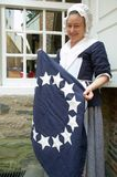 Betsy Ross actor holds colonial flag Stock Photo