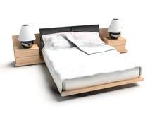 Bett auf einem weißen Hintergrund Lizenzfreies Stockfoto
