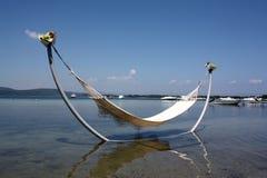 Bett im Meer Stockfotografie