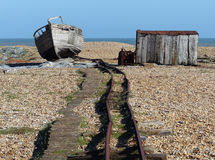 Better days. Relics of the former railway line and old hut at Dungeness, Kent Stock Photo