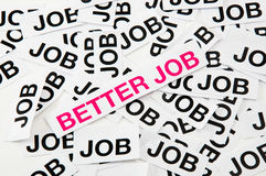 Better job. Printed paper notes with the word Job in black ink, and above them, pronted in magenta, a note with words Better Job royalty free stock photography