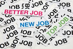 Better job, new job, top job. Printed paper notes with the word Job in black ink, and above them, notes with words Better stock photo