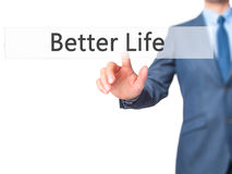 Better Life - Businessman hand pressing button on touch screen i Stock Photography