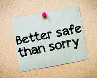 Better safe than sorry. Message. Recycled paper note pinned on cork board. Concept Image Royalty Free Stock Photos