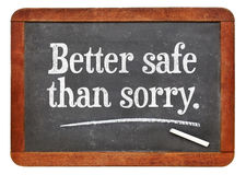 Better safe than sorry proverb. White chalk text on a vintage slate blackboard Stock Images