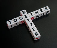 Better together; campaign slogan. Text 'better' and 'together' in black uppercase letters inscribed on small white cubes and arranged crossword style with common Royalty Free Stock Photography
