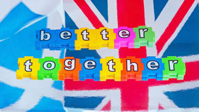 Better Together Campaign. Text  better together  on colorful jigsaw style pieces with white letters on top of the Scottish Saltire flag and the Union Jack flag Stock Images